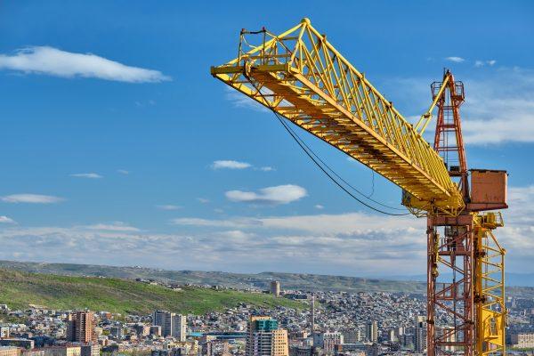 jib-crane-tower-against-blue-sky.jpg