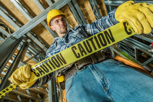 worker-with-caution-tape.jpg